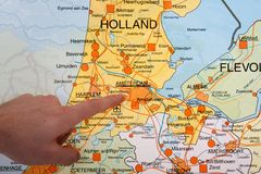 Dutch map with a hand pointing to Amsterdam Stock Image