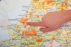 Dutch map with hand pointing to city The Hague Stock Photo