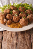 Dutch meat croquettes Bitterballen and mustard close up. vertica Royalty Free Stock Images