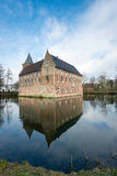 Dutch medieval castle reflected in the moat Royalty Free Stock Photos