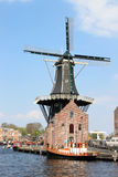 Dutch mill De Adriaan along Spaarne in Haarlem Royalty Free Stock Photo