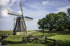 Dutch Mill in landscape. Holiday house europe netherlands landscape sky shot scenery water living holland travel cloudy image wind vacation dutch reflection Royalty Free Stock Images