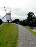 Dutch mill. These a dutch mill at the top of the hill. Try to reach stock photos