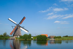 Dutch mill at the waterside Royalty Free Stock Photo
