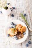 Dutch mini pancakes called poffertjes Royalty Free Stock Image
