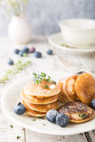 Dutch mini pancakes called poffertjes Royalty Free Stock Image