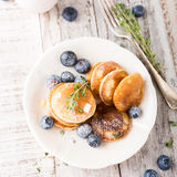 Dutch mini pancakes called poffertjes Stock Image
