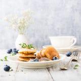 Dutch mini pancakes called poffertjes Stock Photography