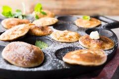 Dutch mini pancakes called poffertjes Stock Photo