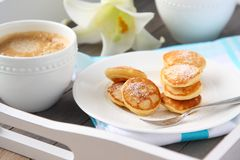 Dutch mini pancakes called poffertjes Stock Images