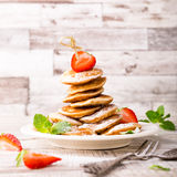 Dutch mini pancakes called poffertjes Royalty Free Stock Photo
