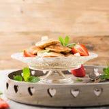 Dutch mini pancakes called poffertjes Stock Images