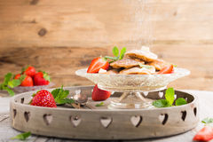 Dutch mini pancakes called poffertjes Stock Photos
