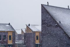 Dutch modern rooftops covered in snow during snowy weather, Neighborhood in the Netherlands, modern architecture background stock photography
