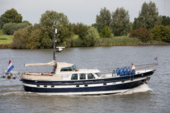 Dutch motorboat. Dutch yacht on the river Lek in the Netherlands Stock Images