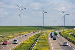 Dutch motorway near Lelystad with wind turbines and blooming rapeseed. Dutch motorway A6 near Lelystad with wind turbines and blooming rapeseed stock image