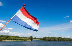 Dutch national flag on the stern of a boat Stock Photography