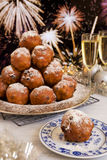 Dutch New Year's Eve with oliebollen, a traditional pastry Royalty Free Stock Photography