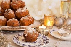 Dutch New Year& x27;s Eve with oliebollen, a traditional pastry Royalty Free Stock Photo