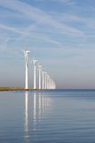 Dutch offshore wind turbines in a calm sea Stock Photos