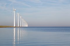 Dutch offshore wind turbines in a calm sea royalty free stock image