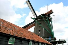 Dutch oil mill De Zoeker and shed Stock Images