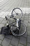 Bicycle lying on the ground royalty free stock photography
