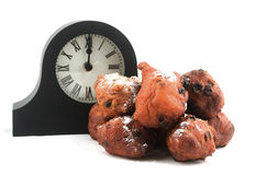 Dutch oliebollen withe clock Royalty Free Stock Photos