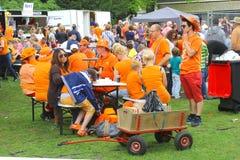 Dutch people in orange clothing at Koningsdag (Kingsday),Netherlands. Dutch orange fans with orange clothing, a folkloristic event during Kingsday (Koningsdag Stock Image