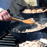 Dutch oven cooking. Stock Images