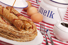 Dutch pancakes with syrup. A stack of Dutch 'pannenkoeken met stroop' or pancakes with syrup Royalty Free Stock Photo