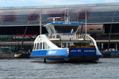 Dutch passenger ferry heading for dock Central Station Amsterdam Stock Photos