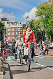 Dutch people on their bicycle, Amsterdam, netherlands. Stock Photography