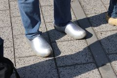 Dutch people walking on clogs during the clog walk in town of Zevenhuizen, The Netherlands.  royalty free stock photos