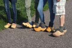 Dutch people walking on clogs during the clog walk in town of Zevenhuizen, The Netherlands.  stock photography