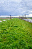 Dutch polder landscape with a curved on a cloudy day Royalty Free Stock Photos