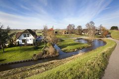 Dutch polder landscape with a farm and some houses. In Capelle aan den IJssel in the Netherlands stock image