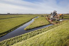 Dutch polder landscape with a farm and some houses. In Capelle aan den IJssel in the Netherlands Stock Images