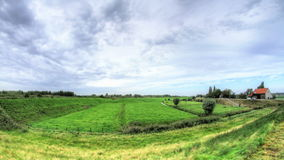 Dutch Polder Landscape. Static wide angle shallow depht of field high dynamic range time lapse shot of a Dutch polder landscape during a cloudy windy day stock footage