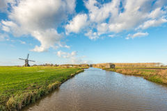 Dutch polder landscape with windmill Stock Image
