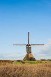 Dutch polder mill against a blue sky Royalty Free Stock Images