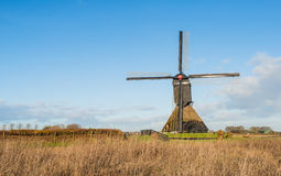 Dutch polder mill against a blue sky Stock Image