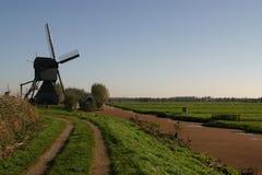 Dutch Poldermodel. Dutch windmill overlooking the Dutch polder Stock Images