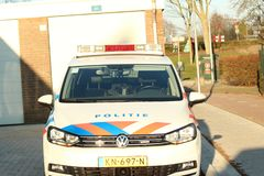 Dutch police car parked on the street in nieuwerkerk aan den Ijssel in the netherlands with text politie which means police in eng. Lish stock photo