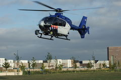 Dutch police helicopter landing in a urban park Stock Images