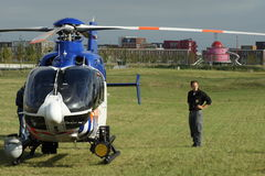 Dutch police helicopter stands in a urban park Royalty Free Stock Images
