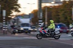 Dutch police man motorbike stock photo