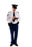 Dutch police officer filling out parking ticket. Stock Images