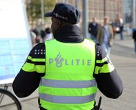 Dutch police officer in the streets of amsterdam stock image