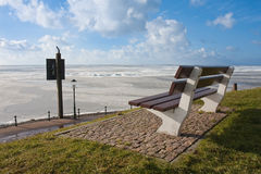 Dutch promenade with frozen sea in wintertime Stock Images
